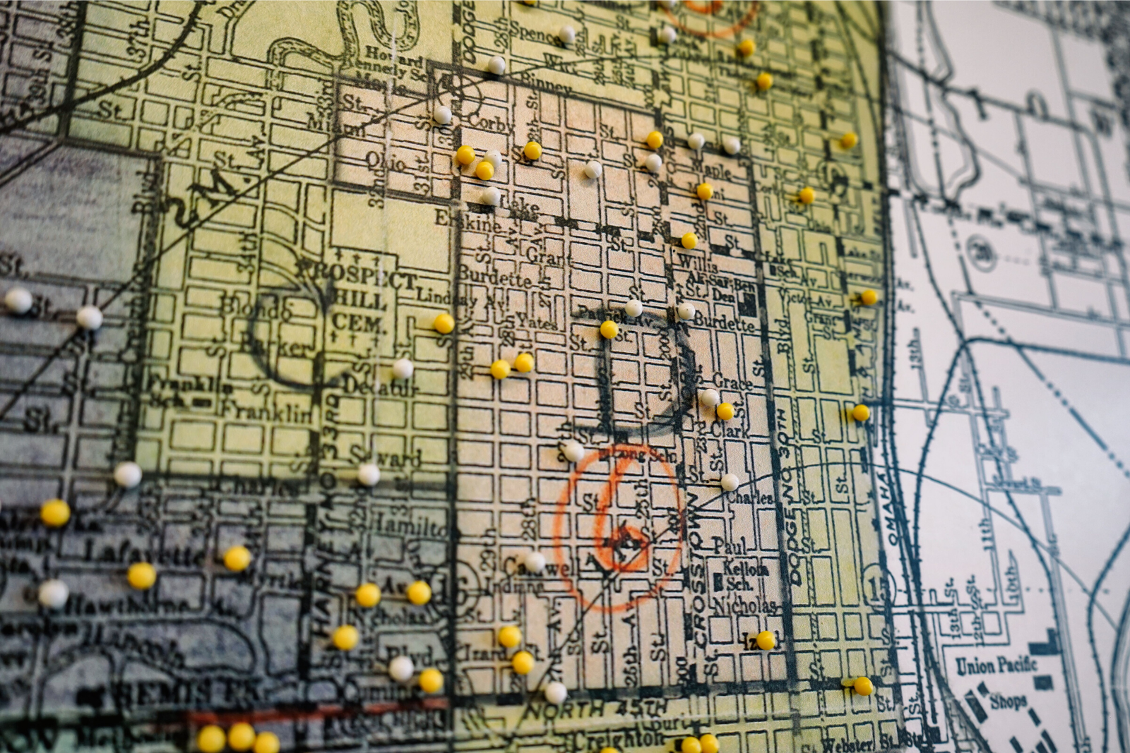 A close up view of Omaha's Redline map with pins placed for home locations of exhibit visitors. (Stories from the redline)